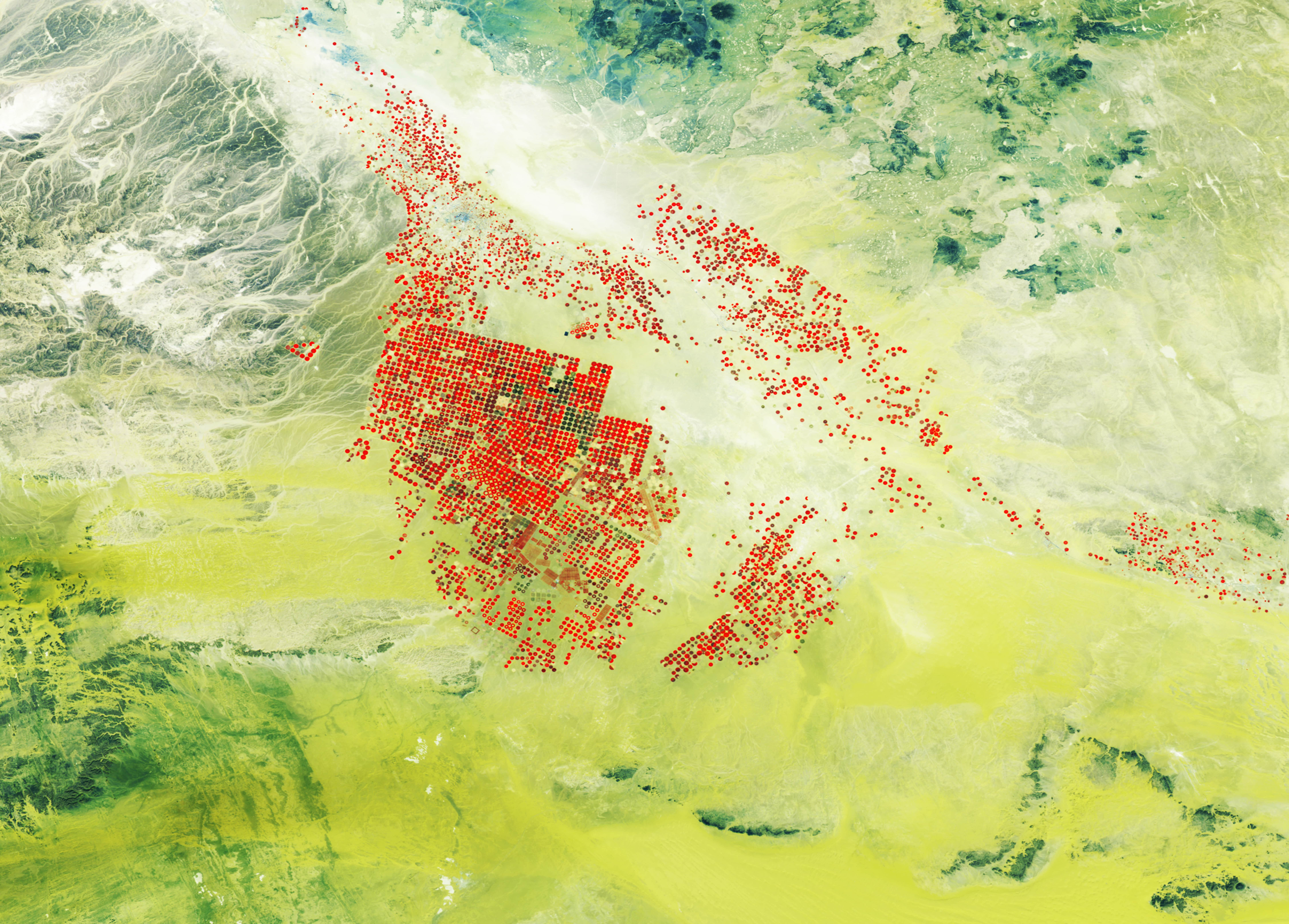 PROBA-V 100 m image of modern agricultural fields with centre-pivot irrigation (in red) and consumption of underground water resources in the Wadi As Sirhan basin of Saudi Arabia